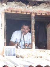 Charging Solar Tuki by local teacher