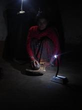 Housewife Using Solar Tuki for preparing Dinner