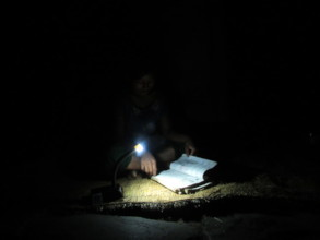 A student studies with the help of solar tuki