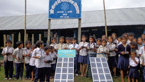 students with solar lamp