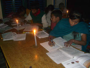 Students studying under candle light