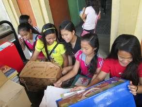 AAI volunteers packing donated school books