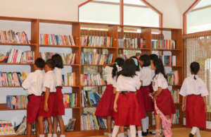 The students enjoy looking for their fave books