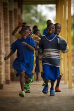 Students Running Near a New Classroom