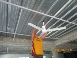 Curtain rails and ceiling fans have been installed