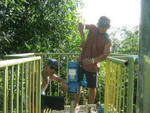 A new water pump being installed thanks to you