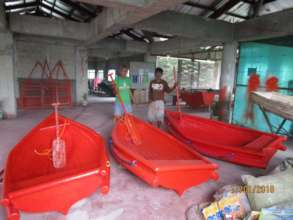 Three new boats waiting to leave the workshop