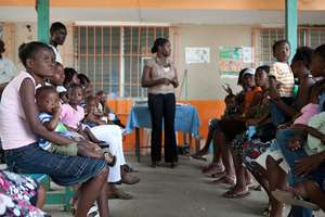 Women and toddlers getting care at clinic