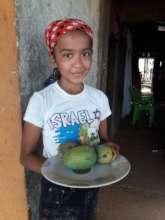 Genesis with her mangoes.