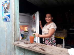 Eugenia serving fresh juice made with clean water.