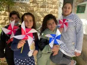 Children at Madaa Creative Center make Pinwheels