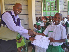 Student from Mwaasua PS recieves a certifiicate