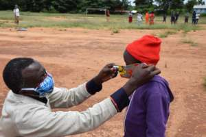 James providing a mask to one of our students
