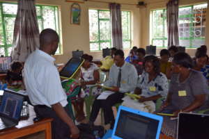 Mr. Mataloo instructs on using tablets