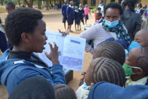 Edith Distributes Guides to Students