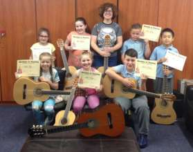 Guitar group showing off their Certificates