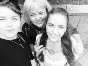 Tetiana Gurska with her biological daughters
