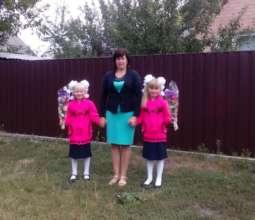 Larysa with Karina and Vika: on the way to school