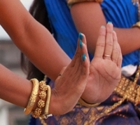 A dancers hands create the Suprech (prayer)