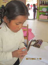 A student is focused on her project