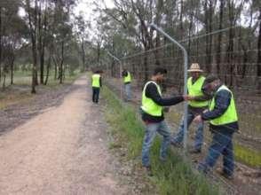 Volunteers maintaining the Park's perimeter fence