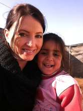 RI staff with a girl she met in the Za'atari Camp