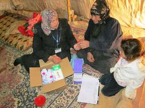 Distributing hygiene kits and discussing needs