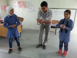 RI teaching some first-graders handwashing