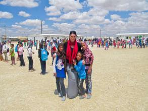RI Emergency Response Coordinator with Syrian kids