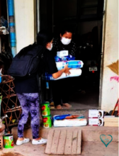 MH foster mother receiving milk and food supplies
