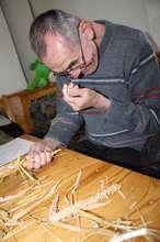 Kiril Scrutinizes a Corn Husk