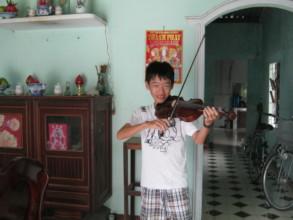 Tu at his home