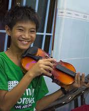 Nhat and his new violin!