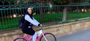Iman promotes outdoor sports by riding her bike