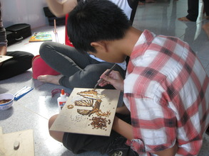 Nhat creating a rice painting.