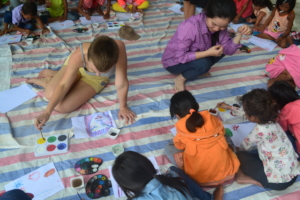 Violet painting with students
