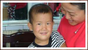 Qiqi and his foster mother