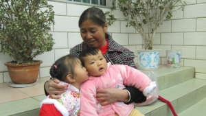 Child and foster family in China