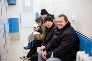 Smiling homeless people in Nochlezhka