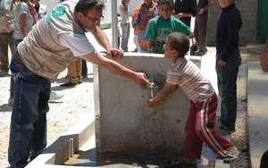 Child washing hands in Zaatari refugee camp