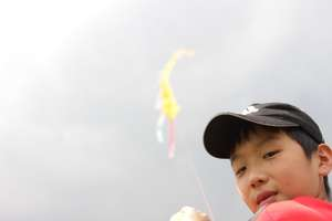 A boy and a kite chain