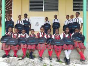 The kids of High Rock Primary with their bags.