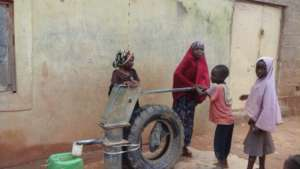 Children all happy for the hand pump