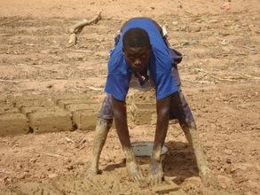 Sagiru making blocks from mud