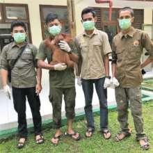 Sapto with the rescue team. Photo courtesy of OIC.