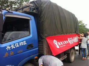 A truck loaded with sheeting and hygiene kits