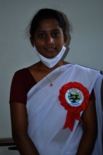 Anusha poses with her program completion ribbon