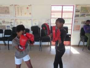 Boxgirls training the basic jabs