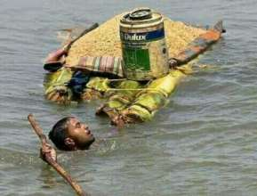 A man is risking his life for few kilo of rice....