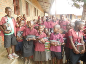 #1:  Students enjoying received school materials
